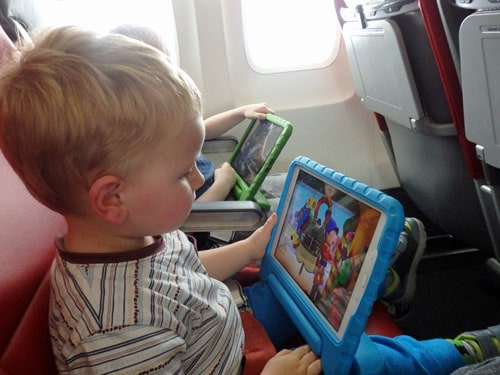 Toddler using tablet on a plane