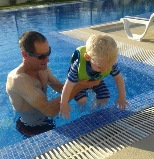 Learning to swim on a villa holiday with kids