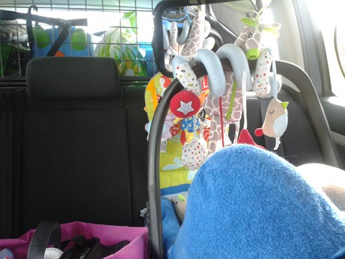 View of a baby car seat with toys attached