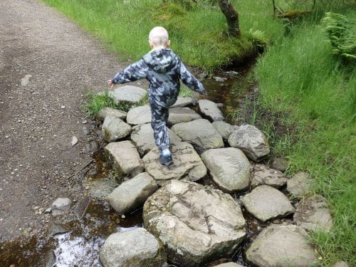 Boy on the stepping stones