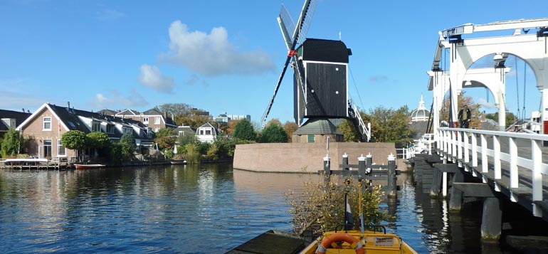 Leiden windmill with boat in foreground