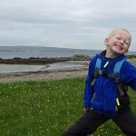 Boy posing while out hiking on Islay