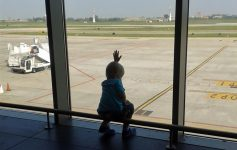 boy watching the planes at the airport