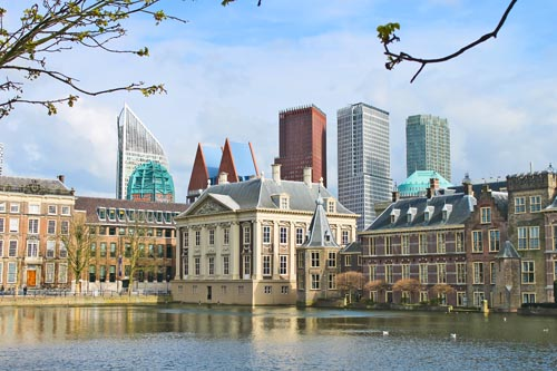 Binnenhof Palace - Dutch Parlamen against the backdrop of modern buildings. Den Haag, Netherlands.