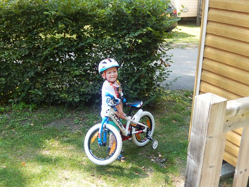 Boy with his bike in France