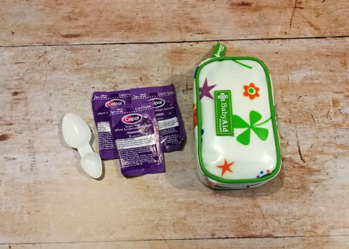 Flatlay with Calpol and First Aid Kit