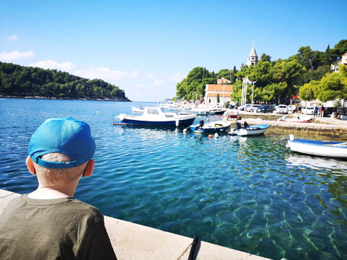 Boy looking over the water in Cavtat