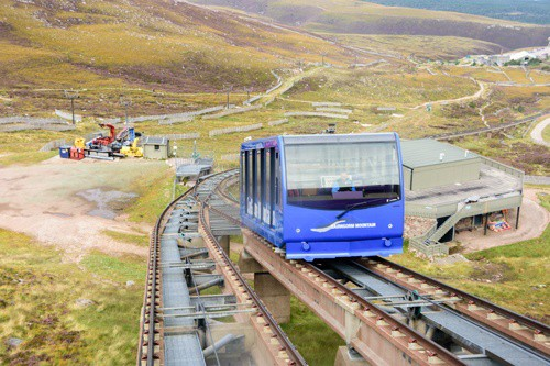 CAIRNGORMS, SCOTLAND - Aug 21, 2017: Funicular train in Cairngorm national park leading tourists in the summers and skiers int he winter to the Cairn Gorm mountain summit
