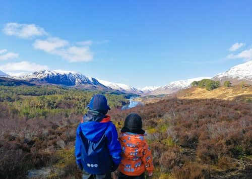 Brothers standing in front of Glen Affric