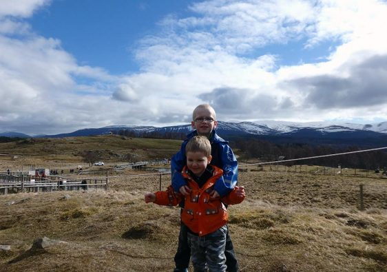 Two young boys in the Scottish Highlands