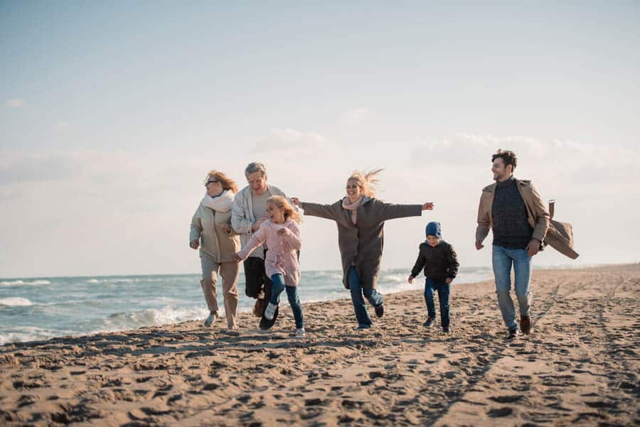 multi-generational family on a beach