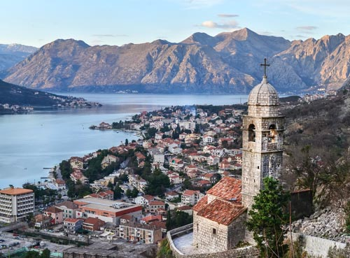 The view over Kotor, Montenegro, the old church, the bay and the mountains from the ancient fortress wall