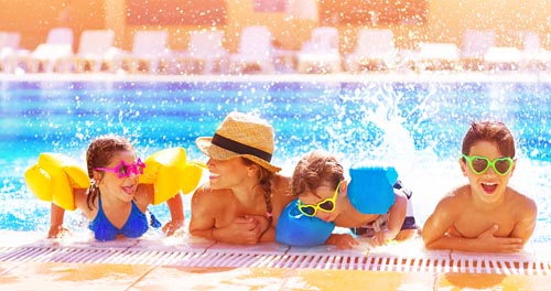 Active happy family having fun in the pool, spending time together in aquapark, summer holidays, joy and pleasure concept